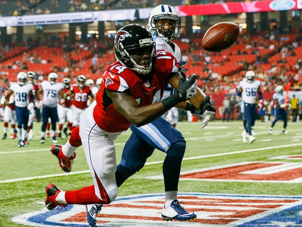 ATLANTA, GA - AUGUST 23: Courtney Roby #14 of the Atlanta Falcons attempts to catch a pass in the endzone against Winston Wright #40 of the Tennessee Titans in the second half of a preseason game at the Georgia Dome on August 23, 2014 in Atlanta, Georgia. (Photo by Kevin C. Cox/Getty Images)
