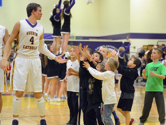 Guerin Catholic's Matt Holba is a big hit with the kids.