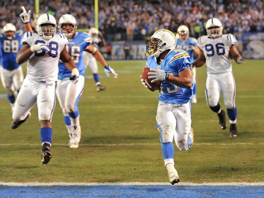 Darren Sproles scores a touchdown against the Colts in a playoff game after the  2008 season.