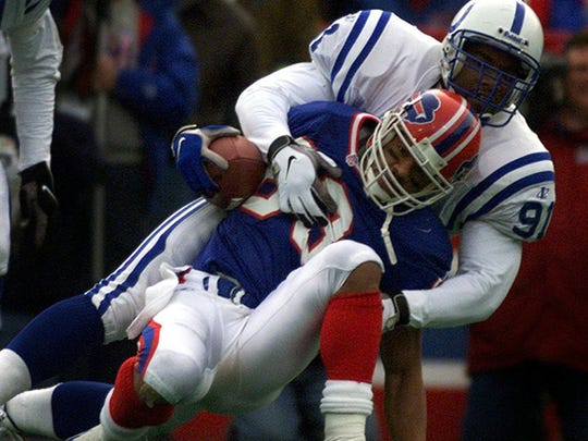 Andre Reed of the Buffalo Bills is tackled against the Colts.