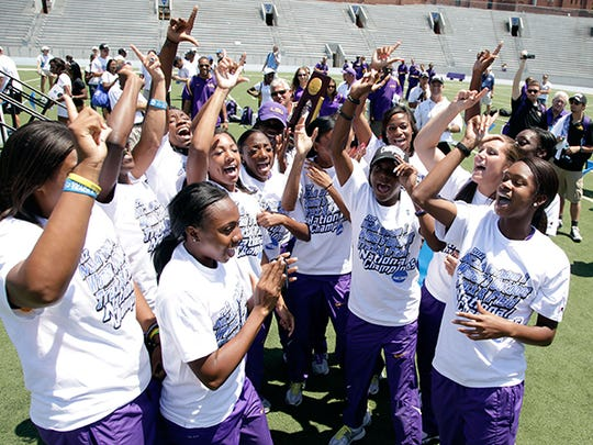 LSU team members celebrate after winning the women's title at the NCAA outdoor track and field championships, Saturday, June 9, 2012, at Drake Stadium in Des Moines, Iowa.