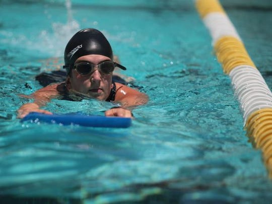 Desert Sun reporter Beth Rossner trains with Piranha coach Jeff Conwell at the Palm Springs Aquatic Center on Thursday, July 17, 2014.