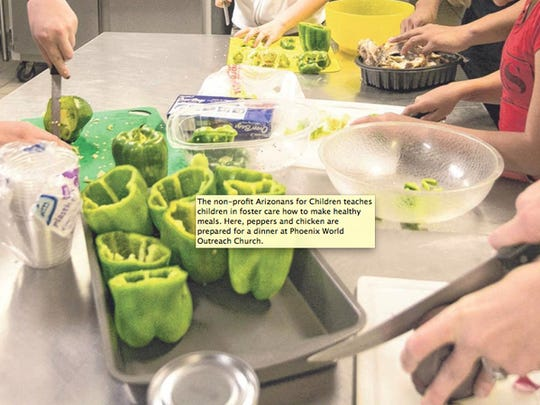 The non-profit Arizonans for Children teaches children in foster care how to make healthy meals. Here, peppers and chicken are prepared for a dinner at Phoenix World Outreach Church.
