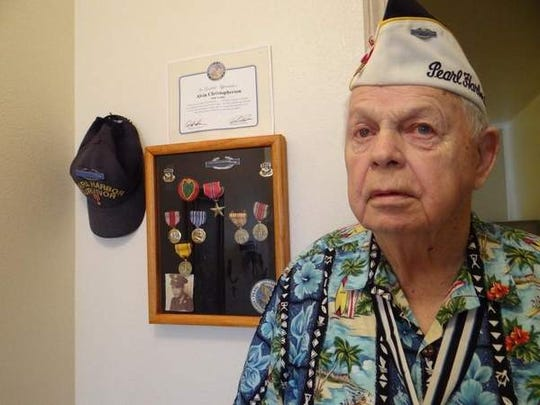 Alvin 'Bud' Christopherson is proud of his Army medals and ribbons on display in the hallway of his South Salem apartment. Christopherson is a Pearl Harbor survivor.