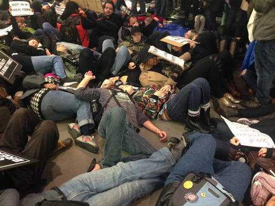 "Dozens staged a ""die-in"" in New York."