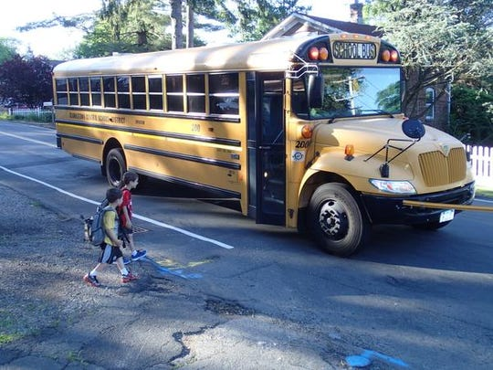 Amy Stevens used this photo, of Aaron and David Silverman getting on a Clarkstown school bus, to help return the camera she found in Maine to Yelena and Rob Silverman in New City. Rob Silverman left the camera on top of their car during their vacation.