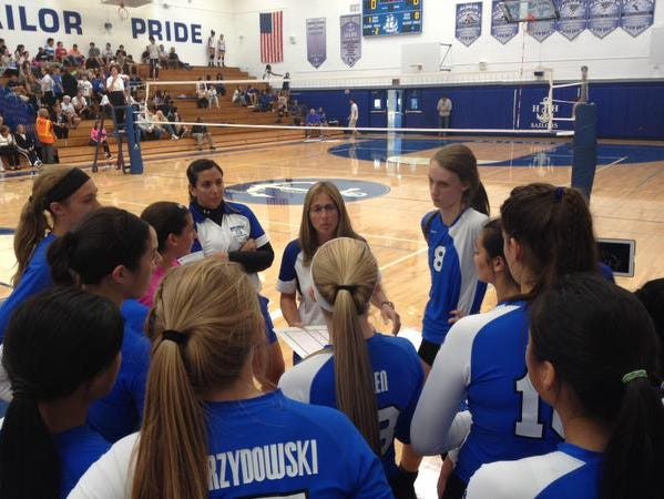 Hendrick Hudson volleyball coach Diane Swertfager talks to her team in between games against Walter Panas High School Sept. 23, 2014.