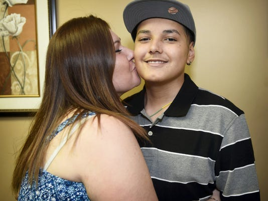 Emma Flores of Lebanon kisses her 13-year-old son, Reynaldo, who has choroid plexus carcinoma, a rare cancer. Flores recently attended the 25th annual Texas Hill Country Adventure in San Marcos, thanks to the Sunshine Kids Foundation, a Houston-based non-profit organization that is dedicated to providing positive experiences for young cancer patients.