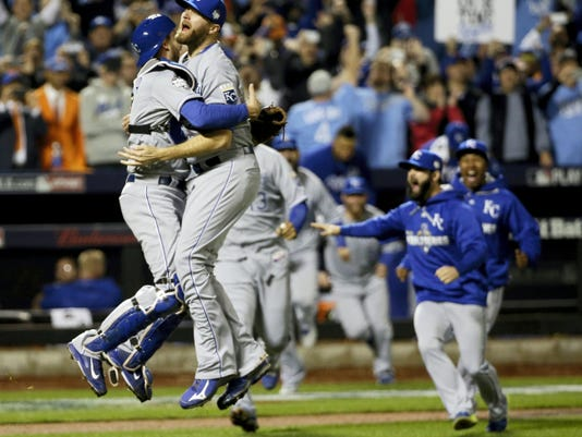 Kansas City Royals catcher Drew Butera and Wade Davis celebrate after winning Game 5 of the World Series against the New York Mets early today in New York.
