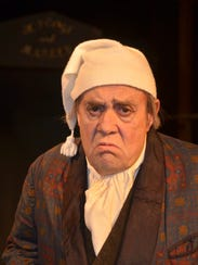 John Welsh in the role of Scrooge in Riverfront Playhouse's