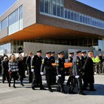 Police officers, troopers, firefighters and and first responders from area departments lined the street as pallbearers pass with the casket of St. Cloud Assistant Police Chief Richard Wilson after a ceremony at the St. Cloud Police Department.