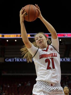 Louisville's Kylee Shook grabs one of her three rebounds.