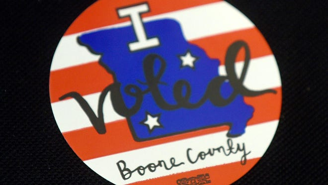 """Voters received """"I Voted in the Boone County election"""" stickers at the Columbia Public Library precinct 4I in the primary election."""