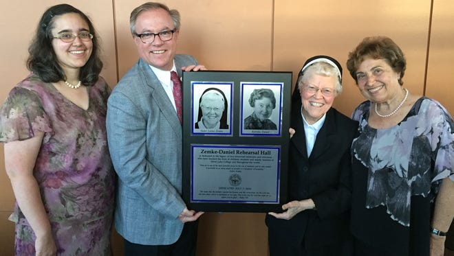Sister Lorna Zemke was honored by Silver Lake College Thursday evening with the creation of the Sister Lorna Zemke Endowed Faculty Fund for Music Education and a dedication of the Zemke-Daniel Rehearsal Hall in the Franciscan Center for Music Education and Performance. The fund was established through an initial gift from Katinka Daniel's daughter, Alexa Maland, and her husband, Lynn, of Salt Lake City, Utah. Alexa attended the ceremony accompanied by her daughter, Sarah. Pictured are Sarah, from left; Dr. Chris E. Domes, president of Silver Lake College; Sister Lorna; and Alexa. The plaque will be placed inside the Zemke-Daniel Rehearsal Hall.