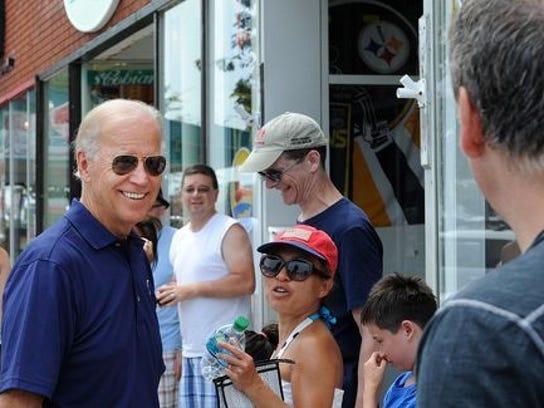 Vice President Joe Biden greets people on Rehoboth
