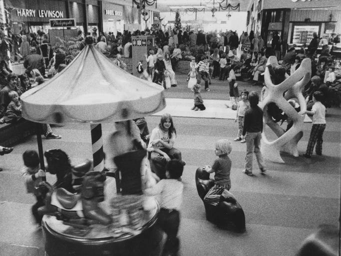 The mall at Washington Square was a fairyland as youngsters played in the children's area during the busy 1975 Christmas shopping season.