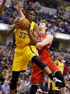 Indiana Pacers forward Myles Turner (33) grabs a rebound in front of New Orleans Pelicans center Omer Asik (3) during the first half of an NBA basketball game in Indianapolis, Thursday, March 24, 2016. (AP Photo/Michael Conroy)