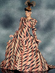 """""""Inspiring Beauty: 50 Years of Ebony Fashion Fair"""" at the University of Rochester's Memorial Art Gallery exhibits 40 show-stopping ensembles, like this Vivienne Westwood ball gown."""