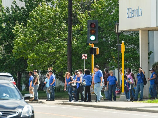 Employees leave Electrolux and cross 33rd Avenue North last year during an afternoon shift change in St. Cloud. The plant is set to close on November 1.