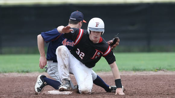 Fox Lane's Henry Davis (32) slides in safe at second during baseball action against Horace Greeley at Fox Lane High School in Bedford on Thursday, April 27, 2017.  Fox Lane won 5-1.