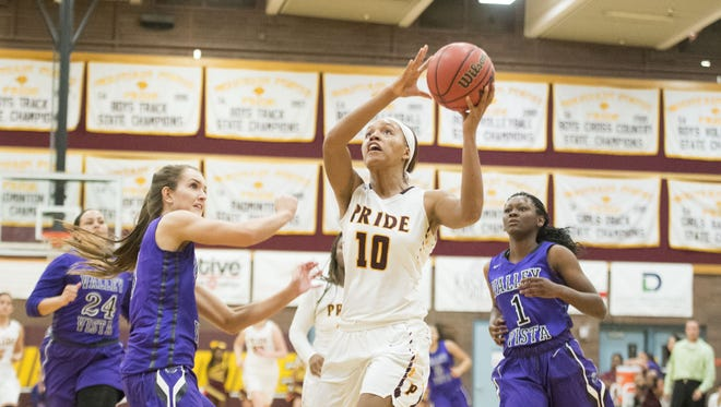 Mountain Pointe's Jenise Strover (10) goes up for a layup against Valley Vista in the first half at Mountain Pointe High School in Phoenix on Friday, Dec. 2, 2016.