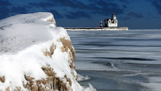 Ice piles up along the shoreline of Lake Michigan in Kewaunee.
