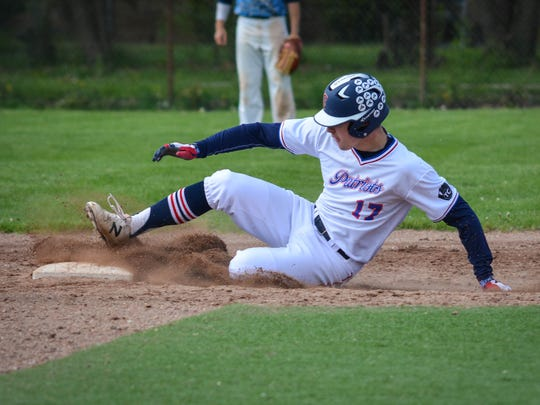 Sliding into second base with a double in the city championship final is Livonia Franklin senior Kolby Dewhirst.