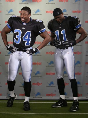 Detroit Lions running back Kevin Jones, left, and wide receiver Roy Williams model alternate jerseys in Allen Park on April 21, 2005.