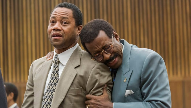 O.J. Simpson (Cuba Gooding Jr.) and attorney Johnnie Cochran (Courtney B. Vance) react to the verdict in 'The People v. O.J. Simpson: American Crime Story.'