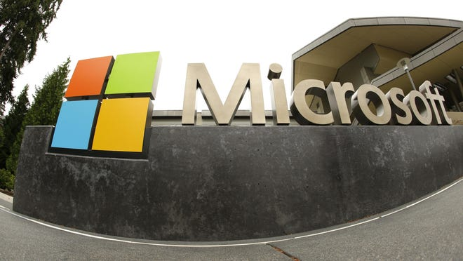 This July 3, 2014, file photo, shows the Microsoft Corp. logo outside the Microsoft Visitor Center in Redmond, Wash. Microsoft said Monday, June 13, 2016, it is buying professional networking service site LinkedIn for about $26.2 billion. LinkedIn, based in Mountain View, Calif., has more than 430 million members.