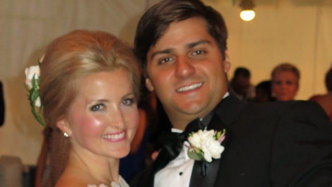 Bride Caroine S. Frierson and groom Brett M. Hernandez dance the first dance at their wedding reception.