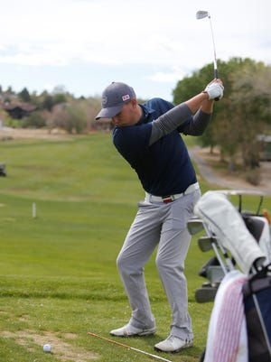 Piedra Vista's Tyler Diehl works on his long drive during Thursday's practice at San Juan Country Club. Diehl, who placed fourth overall as an individual in the 2017 6A state golf championships, looks to help guide the Panthers to a state title this season.