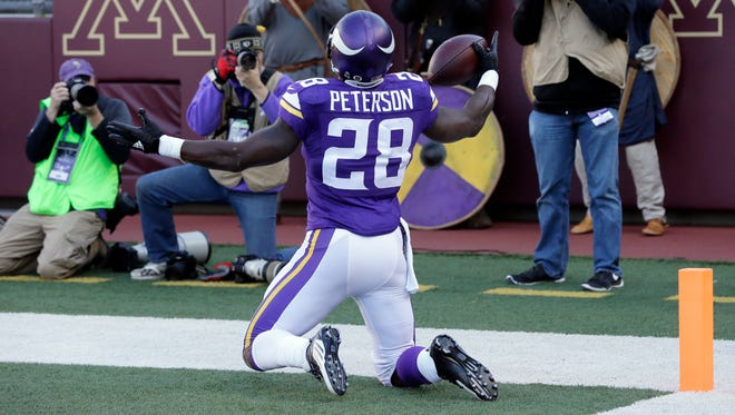 Minnesota Vikings running back Adrian Peterson reacts after his 6-yard run for a touchdown during the first half of an NFL football game against the St. Louis Rams, Sunday, Nov. 8, 2015, in Minneapolis. (AP Photo/Jim Mone)