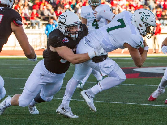 Southern Utah linebacker Taylor Nelson (94) tackles Portland State's quarterback during SUU's homecoming game, Sept. 24, 2016, in Cedar City, Utah.