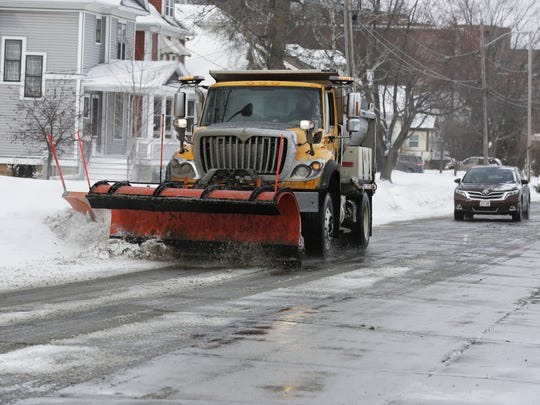 City crews were busy clearing the city streets March 1, after a snow storm left about 3 inches of snow around the area. The main streets like Hazel were the first to be cleared.