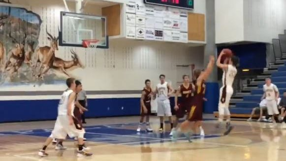 Windsor's Colton McLean (32) hit a buzzer-beating shot to lift the Wizards past Rocky Mountain, 55-53, at Poudre High School on Tuesday.