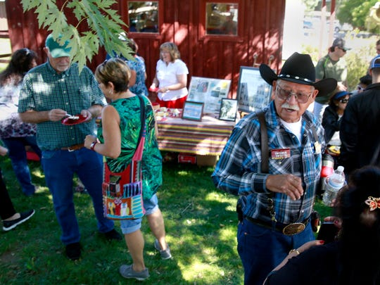 Leonard Trujillo, brother-in-law of Patsy Chavez, talks with a friend during Founders Day on Saturday Sept. 17, 2016, at the Aztec Museum & Pioneer Village. Patsy and her husband, Abe Chavez, were designated Pioneers of the Year at the event.
