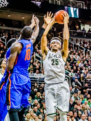 Kenny Goins ,25, of MSU grabs the rebound after he missed a shot during the Spartans' game with Florida.  MSU shot a whopping 37% in the game.
