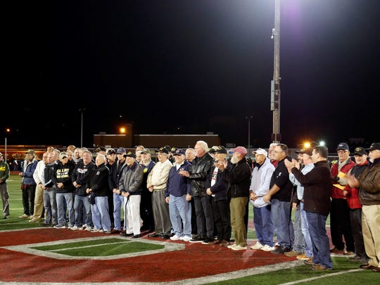 Boonton High School veterans are honored during halftime of a football game Oct. 14, 2016.