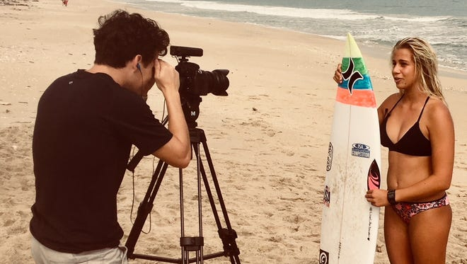 Surfer Rachel Presti of Melbourne Beach films a promotional video for the upcoming Florida Pro Surf competition, scheduled for Jan. 18-26 at Sebastian Inlet. At left is David Morefield of NPI Productions in Cocoa Beach.