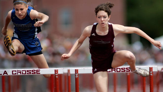 Menomonee Falls' Calanetta Burrows (right) competes in the 100-meter hurdle finials at the state track and field meet in La Crosse on May 31, 2008, in La Crosse.