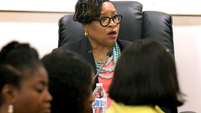 Myneca Ojo gives testimony during the second Pennsylvania Human Relations Commission hearing at York City Council Chambers Friday, June 22, 2018. The hearing was in response to allegations that she and four other members of the Sisters in the Fairway were racially harassed during an incident at Grandview Golf Club in April. Listening to testimony were, foreground, from left, Sandra Thompson, Carolyn Dow and Sandra Harrison who are members of the group. A fifth member, Karen Crosby, also attended. Bill Kalina photo