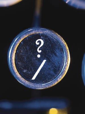 GETTY IMAGES Forward slash and question mark key on typewriter