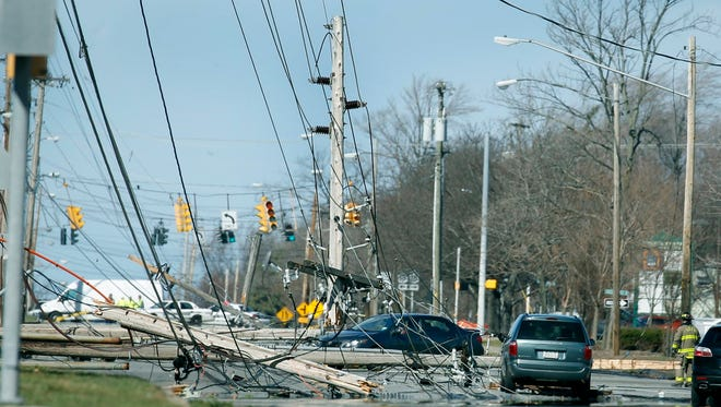 Power lines block traffic on Long Pond Road in Greece.