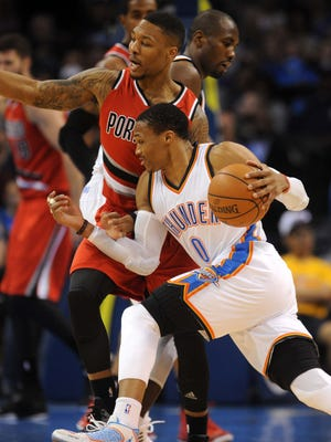Russell Westbrook, front, and Damian Lillard each poured in 40 points.