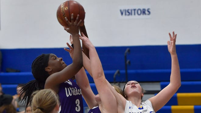 Green Bay West's Antonia King, left, secures a rebound against Gibraltar's Payton Pluff, right, during a nonconference girls basketball game on Dec. 12 in Fish Creek. In middle is West's Sarah Snyder and foreground is Jazzlynn Koeller. West is hosting its first WIAA playoff game since 2001 on Tuesday.