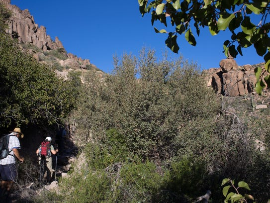 Hikers venture along the Peralta Trail  in the Superstition