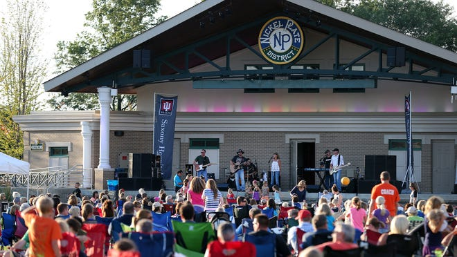 The Blue River Band performs at the Nickel Plate Amphitheater, Tuesday, July 8, 2014. Thousands of people turn out weekly for the concert series.