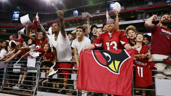 Arizona Cardinals fans cheer during the opening day of training camp on Jul. 22, 2017 in Glendale, AZ.