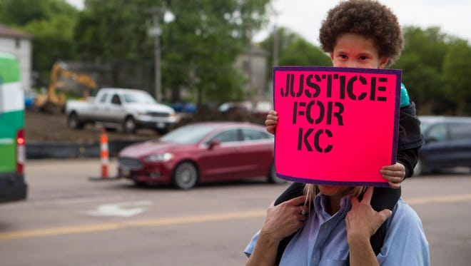 Tina Crawford and Myah Bickett, 4, participate in a protest in downtown Sioux Falls, S.D. on Monday, May 21, 2018 over the judge's decision to allow Alex Lingor a furlough from Juvenile Detention Center to attend graduation ceremony from Roosevelt High School.